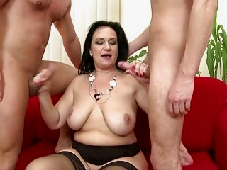 Watch - Mature sex bomb mom serves two young cocks
