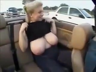 Watch - Amateur blonde plays with her huge natural tits in a car